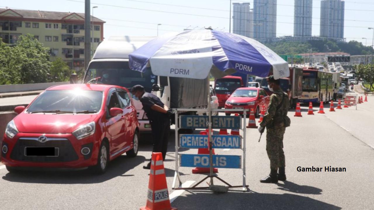 Warga Indonesia Tumbuk Polis Ketika Sekatan Jalan Raya PKP